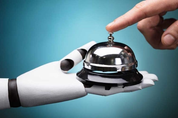 on demand economy - man ringing bell held by robot hand