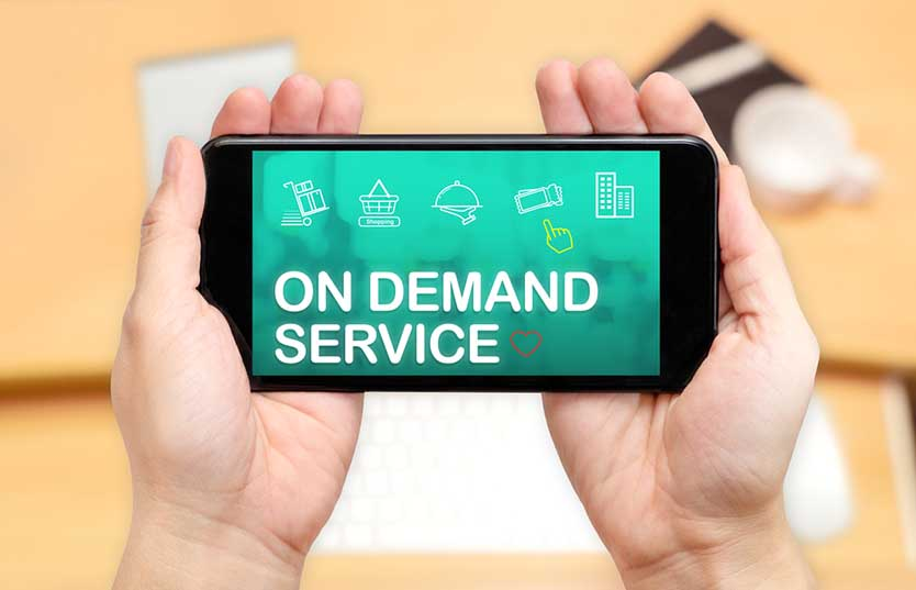 On Demand Economy - hands holding phone
