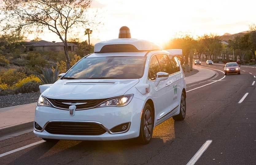 Waymo self driving vehicle on road.